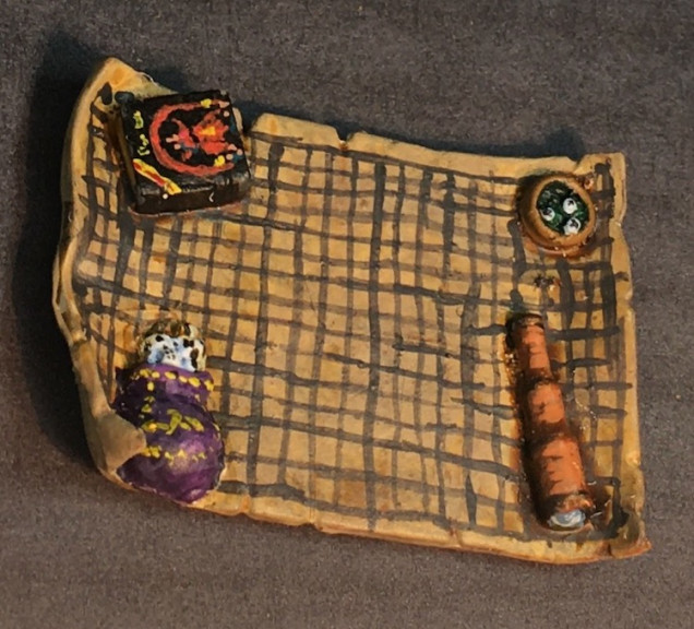 When I was a kid, polyhedral dice were hard to come by and dice bags didn't exist.  It seems like everyone of my generation used a Crown Royal bag which came wrapped around a bottle of whiskey.  Not sure where I got one as my parents didn't drink but that's what I tried to paint this one as.