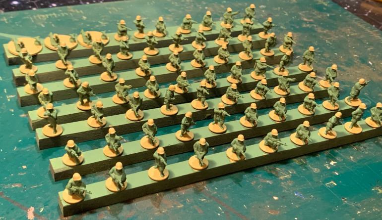 Sand colored helmets and bases.  Boots will be black, flesh hands and faces, two-tone AK weapons, and some more sand web gear to come.  An umber wash, followed by touch up and some basing material, and we'll be done.  With 70 figures ... and in 15mm ... the trick is to not paint each one like a 28mm Golden Button masterpiece.