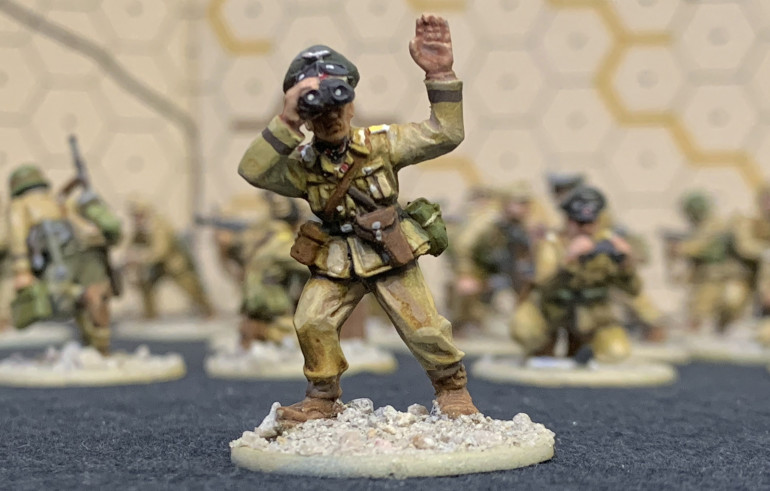 Probably my favorite guy, which I painted generally as a Oberst-Leutnant (Lt. Colonel) battalion commander.  It's a little hidden in shadow but I hope you can see my attempt at Knight's Cross ribbon around his neck and the badge ribbon on his tunic.  This guy's seen some sh*t!  :D All these figures have brown cuffbands to approximate various DAK units, not really aiming at one in particular.