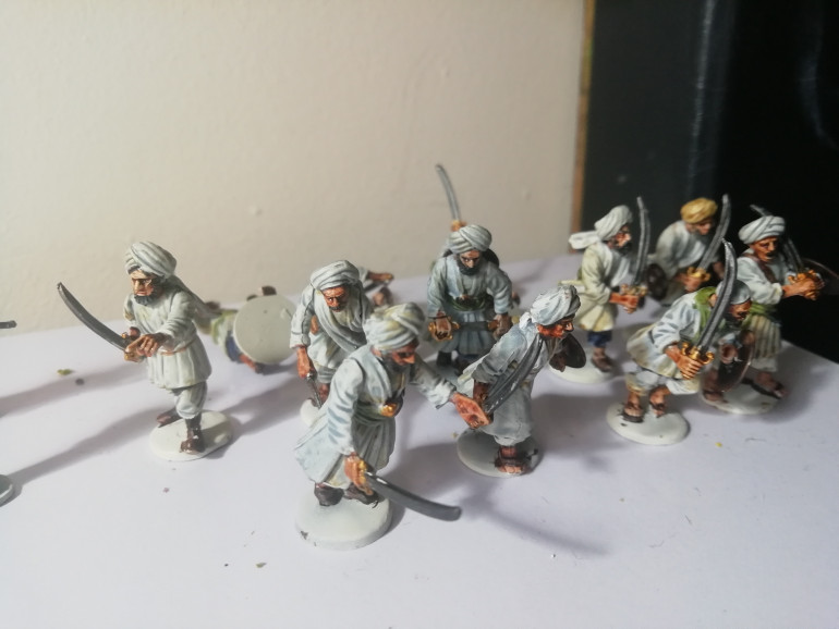 So with a hundred afghans to paint I've started my first unit of 25 ghazni fanatics who wore a lot of white so these are proving quick to do with contrasts. I'm going over the flesh tones with wildwood in an attempt to get a good skin tone. These chaps stick to melee weapons