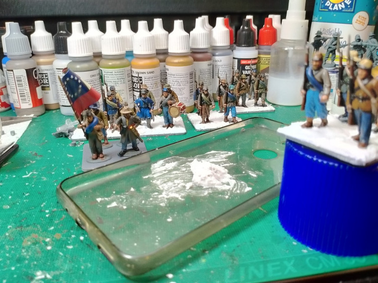 The bases are 40mmx40mm, 4 models per square, 24 in the full regiment.