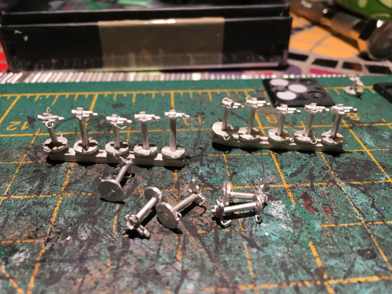 Managed to get hold of some original new on the sprue imperial fighters for Battlefleet Gothic. Just tidying them up before I'll glue them to the bases.