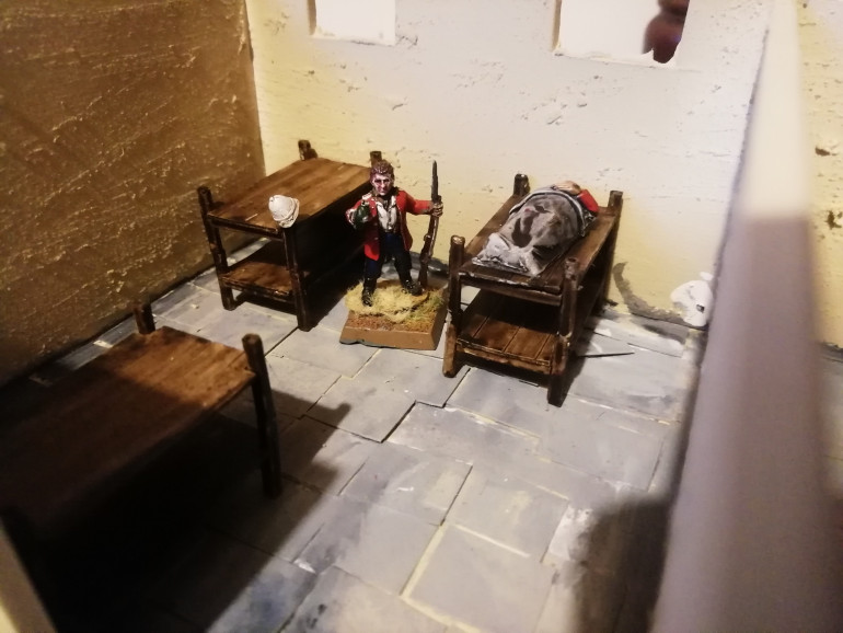 The beds come in bits so you can do them as single beds rather than bunks. I added some pith helmets and painted them movie white