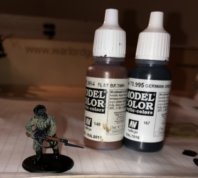 Step 4: Now its time to paint the weapons. I use Flat Brown for wooden stocks (I also pick out bayonet handles located on some of the figures belts and any helmet straps with this colour) and German Grey for metal, which I think gives the metal a nice blue-ish tinge.
