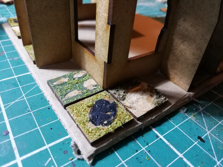 I based each building and used some old square mini stands for pavement before adding rubble piles
