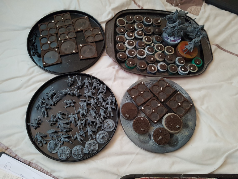 All the 100 Kingdoms models from the 2 player starter set, all built and ready to rpime.  All the bases are prepared, with their sealant coat of PVA currently drying.  They'll be ready to prime in a day.