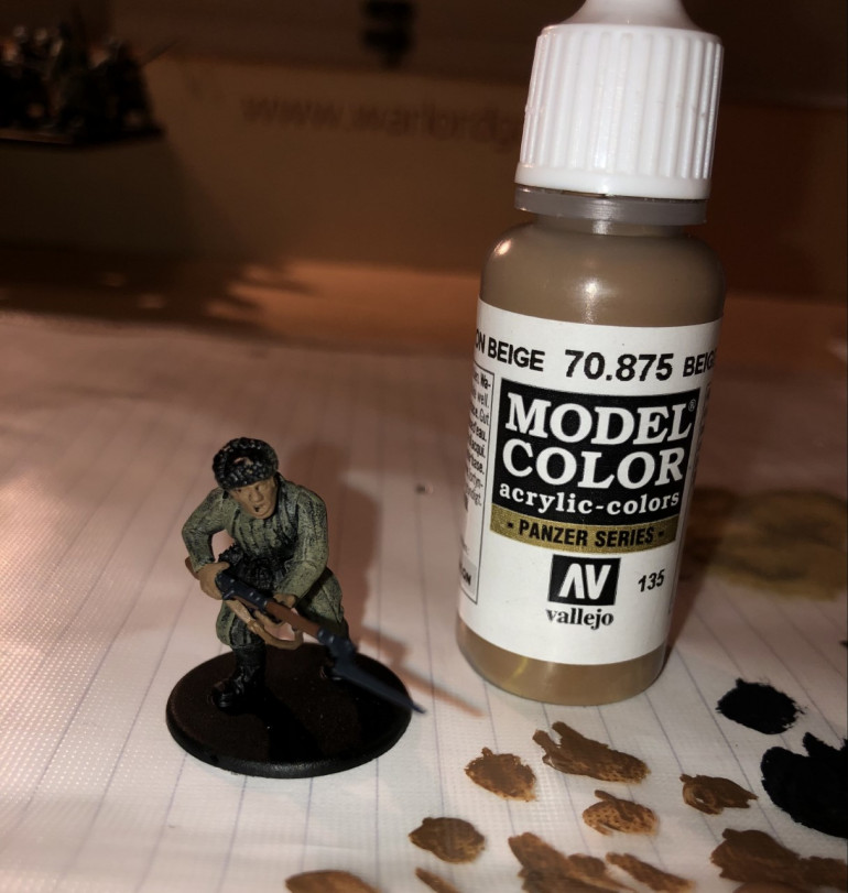Step 5: Next, I paint the flesh with Beige Brown. I also paint any weapon slings this colour.