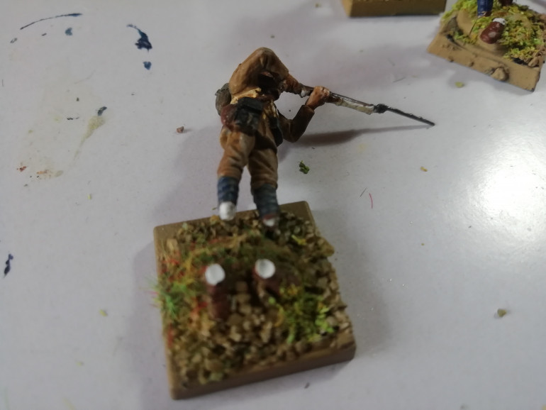 Rebasing my old minis to match my afghans. Had a few casualties along the way. He went feet first.