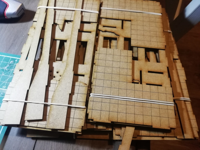 I have picked up 5 very simple ruined buildings from wargames model mods. Only £20 in eBay.