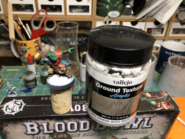That is of course a personal preference, but I love Vallejo Ground Textures. I applied some Rough Pumice over the slot marks and hole of the base. Feel free to cover the whole base with texture if you wish but keep in mind it will be partially covered with grass.