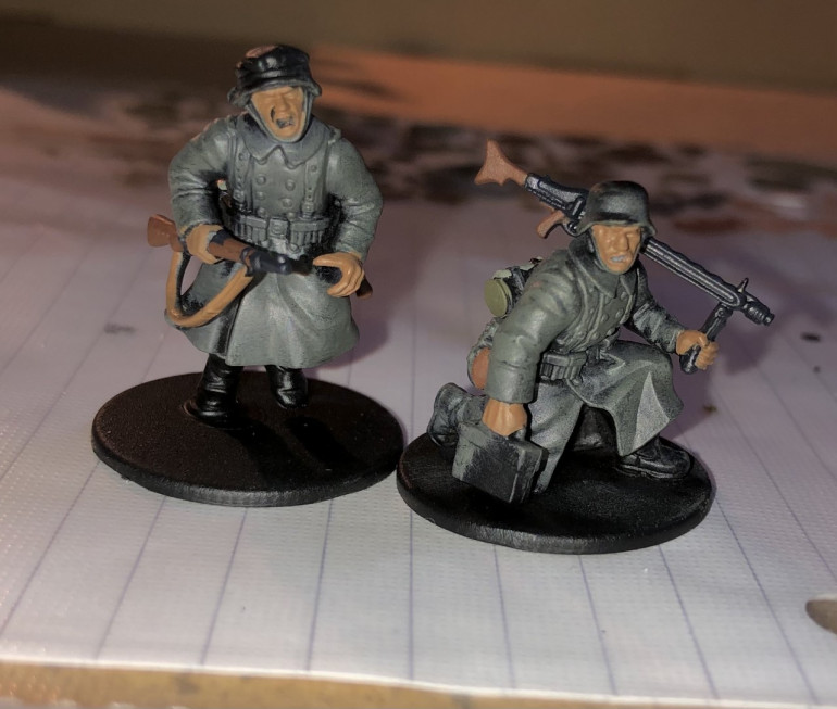 5. Next, I paint the flesh and any weapon slings with Beige Brown.