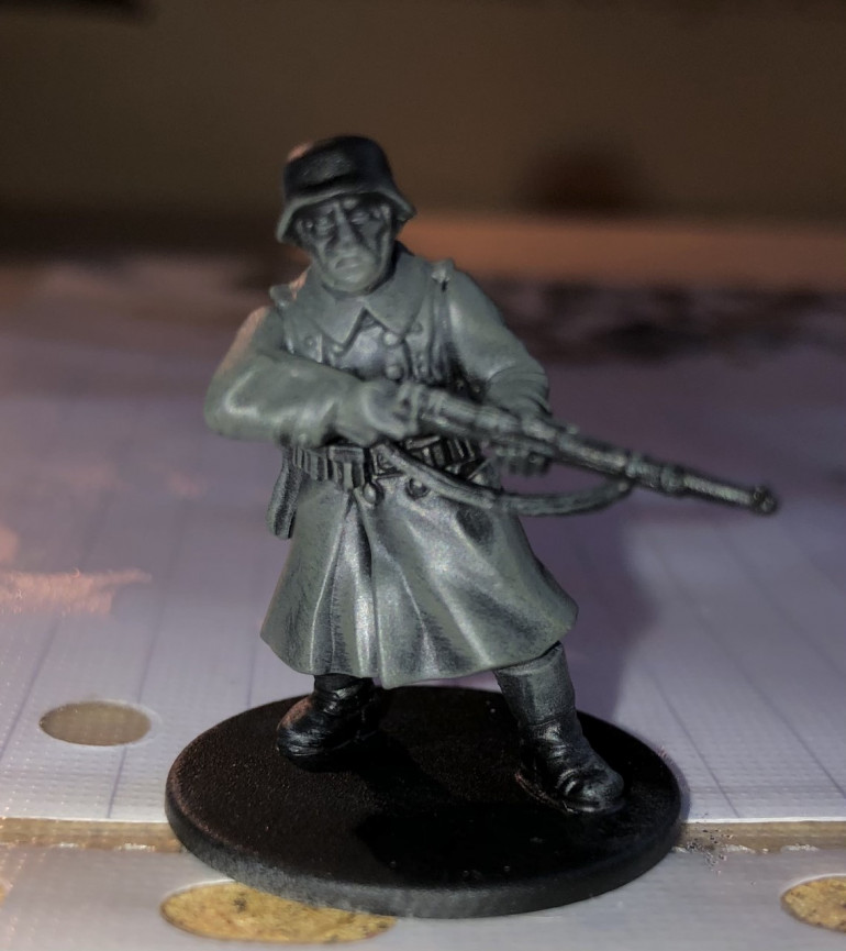 2. Next, I  liberally dry brush the uniform with German Fieldgrey. I also hit the webbing and boots slightly.