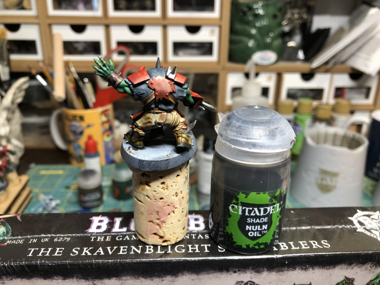 Apply a wash a Nuln Oil; to the shirt.