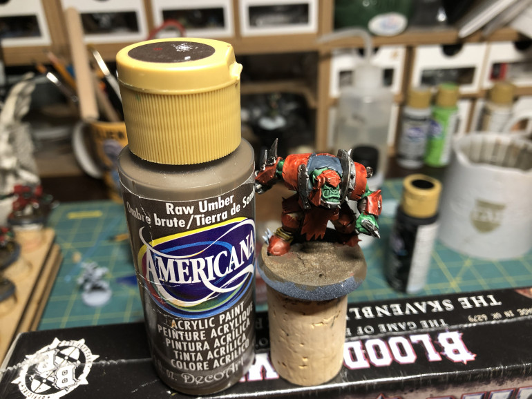 I use brown craft paint to paint the altered base as it is cheaper that hobby paint and has a decent coverage.