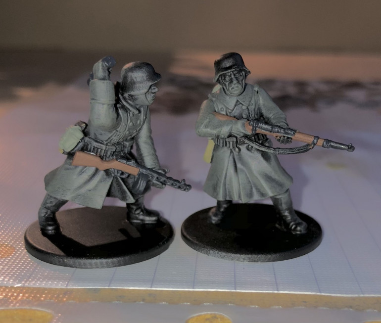 4. Then I paint any wood with Flat Brown such as rifle stocks and entrenching tool handles. I also paint any metal with German Grey.