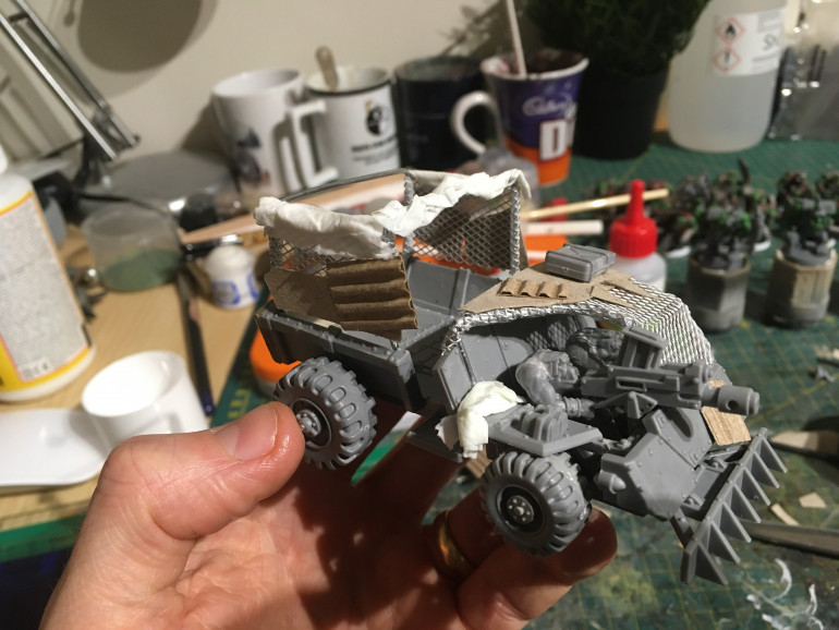 now adding some orky armour panels
