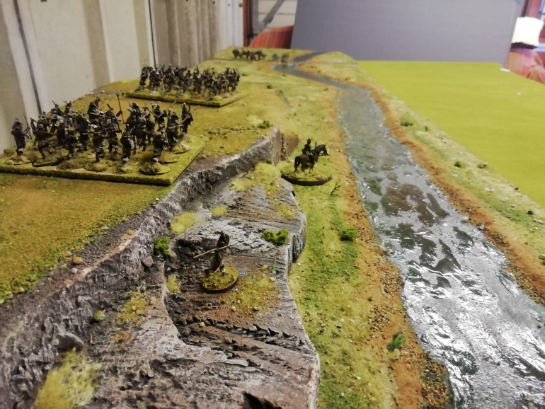 Now my river is finished with this second board which took longer as it had a large hill. I had an old hill I've recycled chopped up repainted and based. I mixed my flock up after looking at my holiday snaps and made the grass more brown on the hills