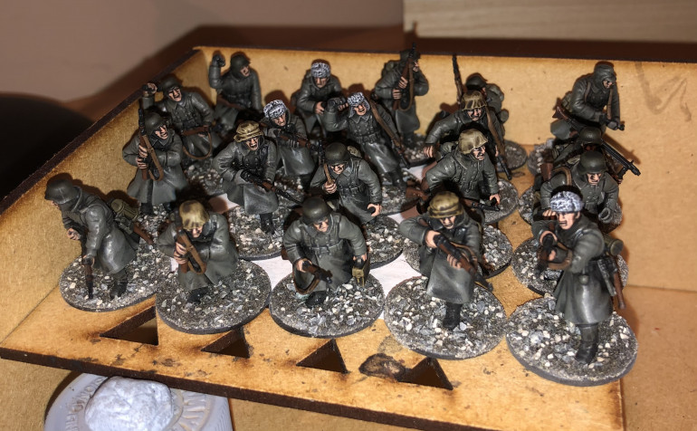 I have now painted ALL of the German infantry and I have begun to base them with my rubble mix! Here's a few of them drying off...