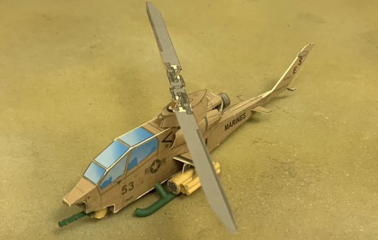 Build the model, using wooden dowels and plastic sprue bits for some of the pieces.  There's also a wooden