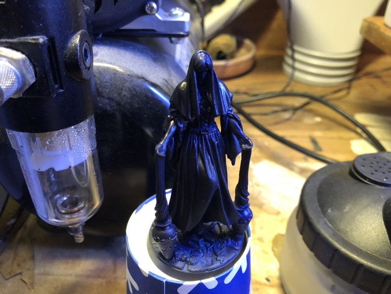 I then airbrushed a layer of Imperial Blue (Vallejo) at 45 degree angle downward, preserving the shadows.