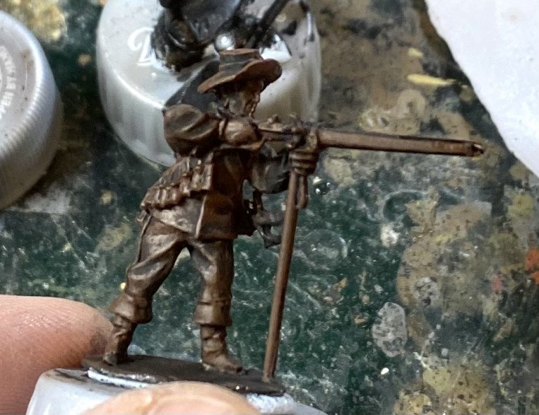 Undercoated figure with a heavy dry brush of Flat Brown.