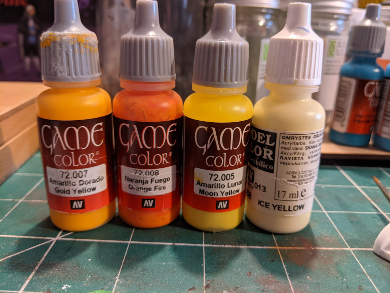 The base coat was Golden yellow, shaded with a mix of the orange.  Highlighting was done with the moon yellow going up to ice yellow at the brightest points.