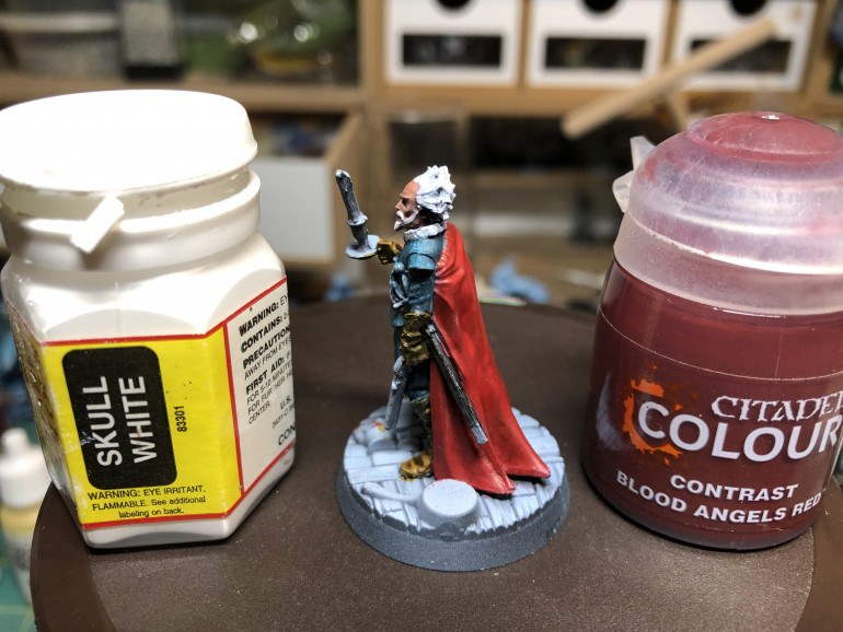 For the cape, I used GW Contrast Blood Angel Red which works great with a zenithal priming. The beard and hair were painted white