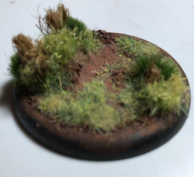 Im going to start by making a scenic base for the sniper team. The long elephant grass is made from an old door mat thats slowely being chopped up.