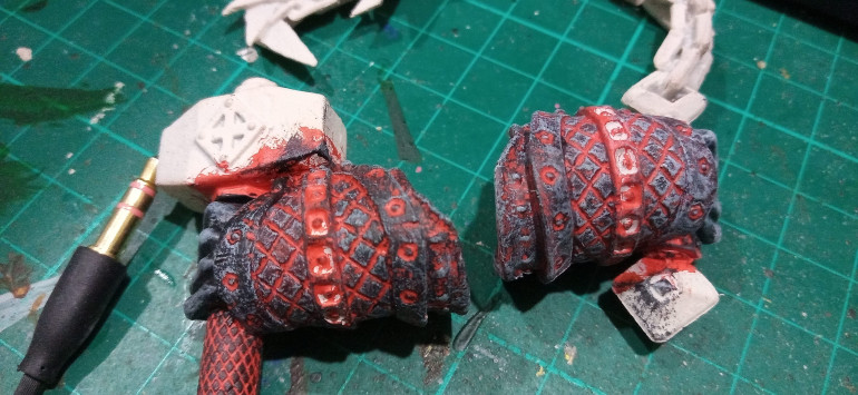 The Left is before the grey drybrush and the right after