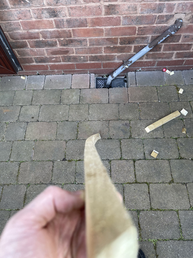 the left over plank showing just how warped it was to start