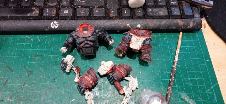 The Skin was painted Black and a rough drybrush of Black of was applied to the armour