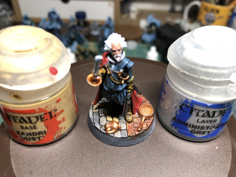 Wood floor (and bandolier/harness) were highlighted with GW Zandri Dust and stones were edge highlighted using GW Administratum Grey, to provide more dimensional contrast.