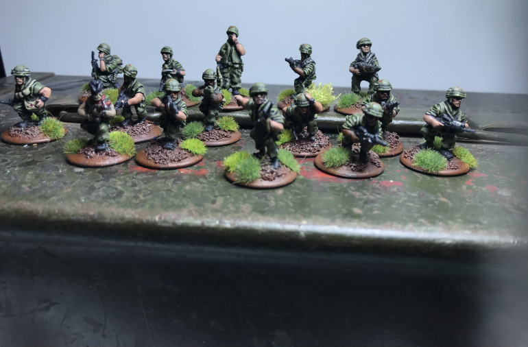 First Rifle squad and command team with attached medic