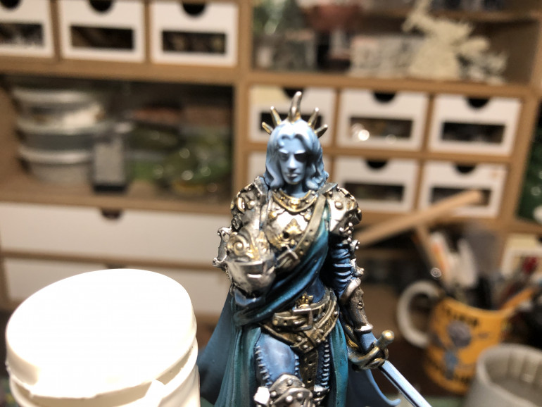 White was also used to highlight the sword edges, hair and facial area. Be light in your application. Less is more…
