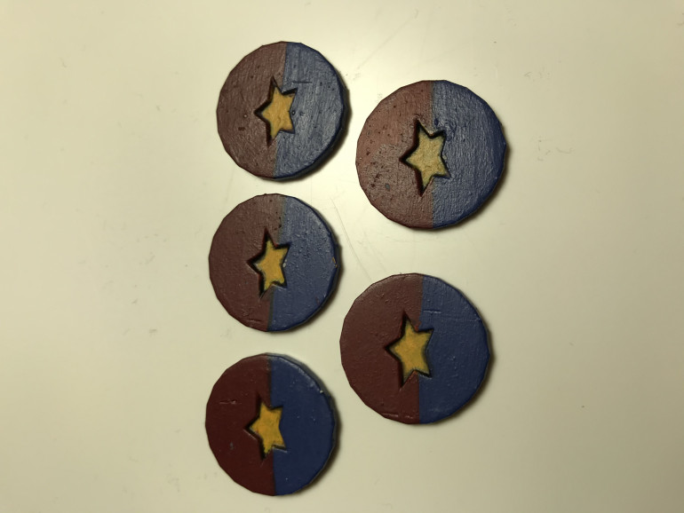 The finished tokens with embossed stars