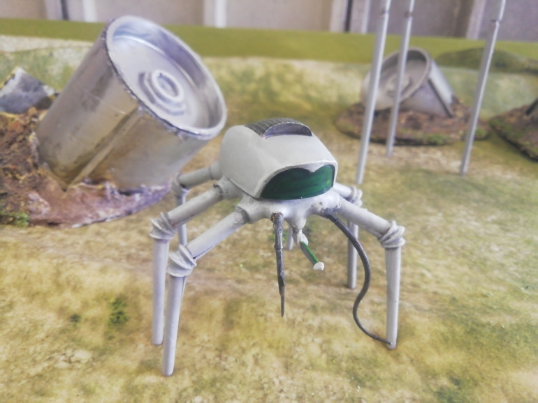 In the original book the narrator of war of the world's described a squat metallic machine that chased it's victims and deposited them into the net on its back. They can be fed on later. My machine was s brass colour but I want it to have a more classic look so have repainted it.