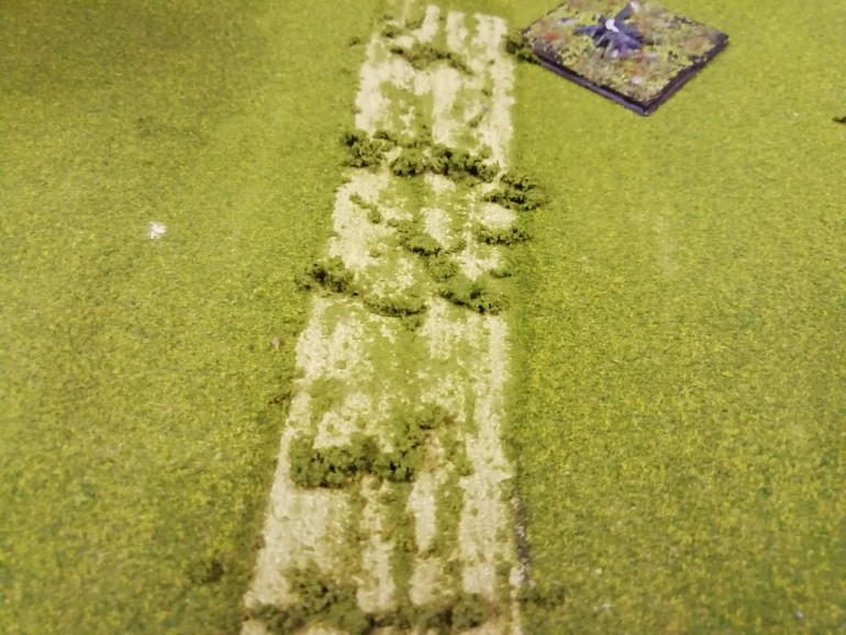 I have an old woodlands scenery mat that gets little use so I'm scraping away the roads leading to Waterloo