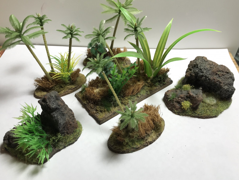 Trees and bushes will be useful to break up line of sight on the table and to conceal ambushing units.
