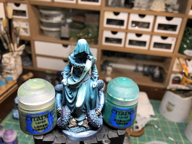 In order to create a subtle contrast on the dress and sash without destroying the airbrush highlights, I applied two diluted glazes of green, one GW Loren FOrest to the sash and one GW Kabalite Green to the dress. Make sure the effect is subtle and do not let it pool in the crevices.