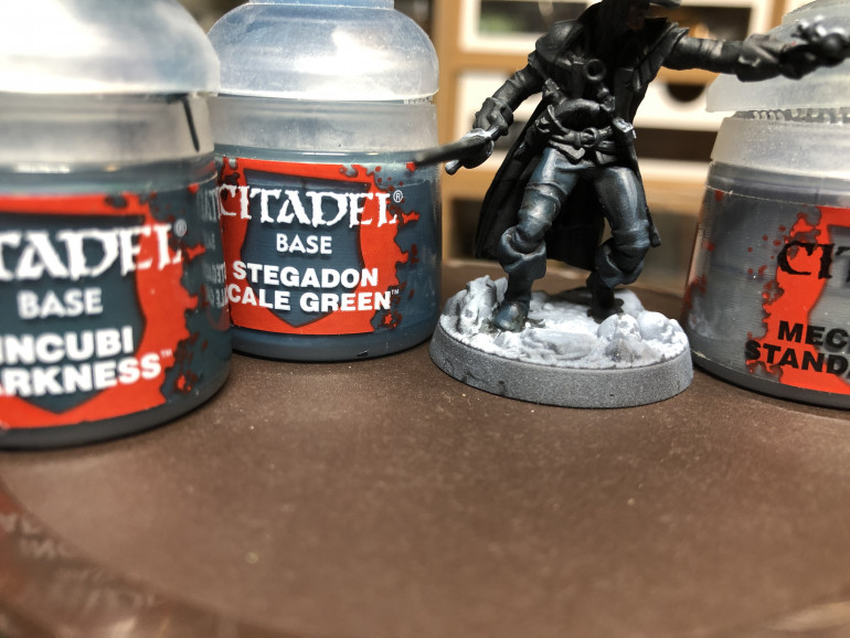 Gallery above - The miniature was then covered with GW Contrast Black Templar - Above - Pants were covered with a thinned out layer of GW Incubi Darkness (as a glaze) then highlighted with GW Stegadon Green and Mechanicus Standard Grey.