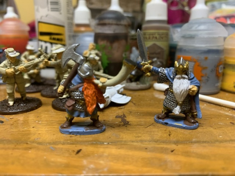 I gave a second thin coat of white and orange for the beards and plate metal mail on the armor.
