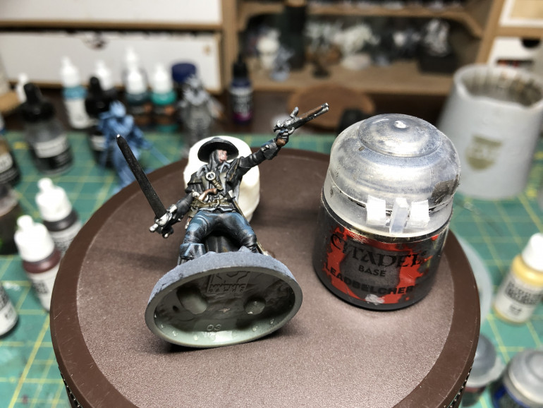 Metallic parts (pistols/buckles/sword) were given a layer of Leadbelcher and a wash of Nuln Oil Gloss