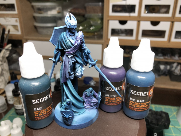 Using Secret Weapon Algae, Amethyst and Blue Black washes (which are more like glazes), I applied three different tints to the virtue cloak, pants and sash.