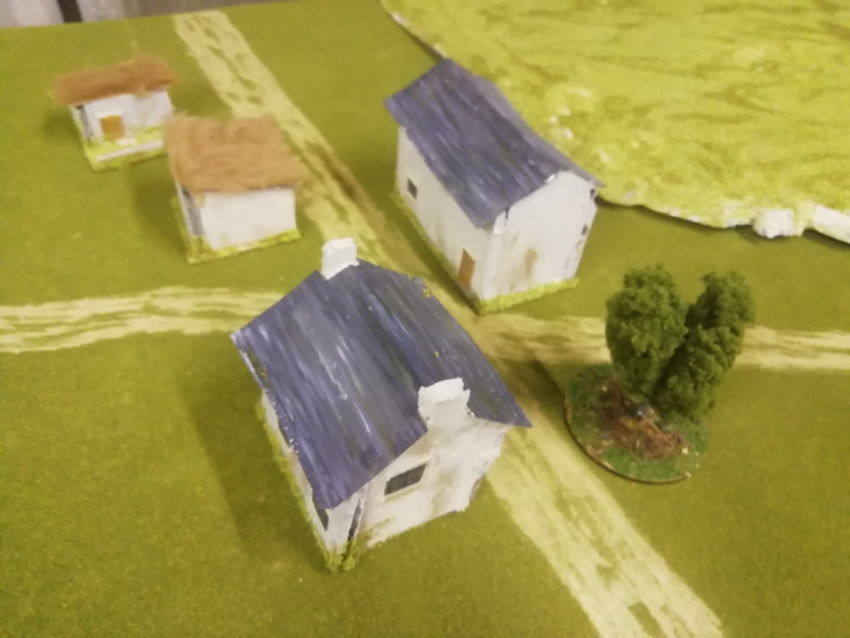 The main objective for the battle is the crossroads which now has some buildings and a tree. Making some hills was a bit hit and miss I got some spring grass flock from woodland scenics because the mat is spring grass. Yet the two don't really match. I also got another mat to extend the field. It was also meant to be spring grass but was darker. Bit if a pain they don't match but I'll see how it looks when done. Feels a bit old school in my approach to putting this table together