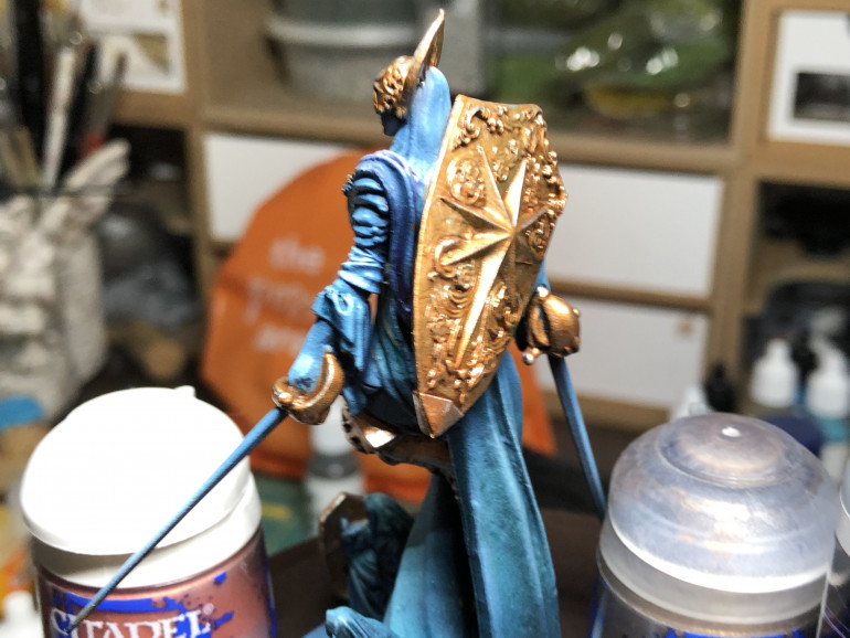 Brass silver highlights are reserved for the areas of the metal most hit by zenithal light. I also highlighted the hair with pure white in the most exposed areas, along with edge highlighting the upper swords' edge with white.