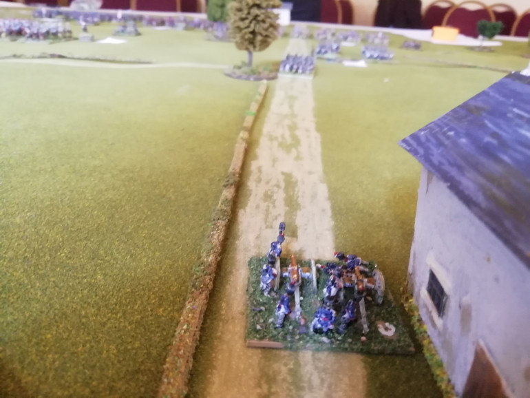 The British deploy artillery in the main road to face the fast marching French who after coming under fire press out across the field