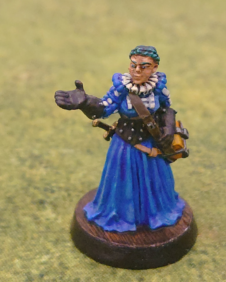 So after another bit of a hiatus, I finished the next one of the Dunkledorfians, Eva Eilhart the Bailiff. I used a combination of contrast and regular paints on this figure.