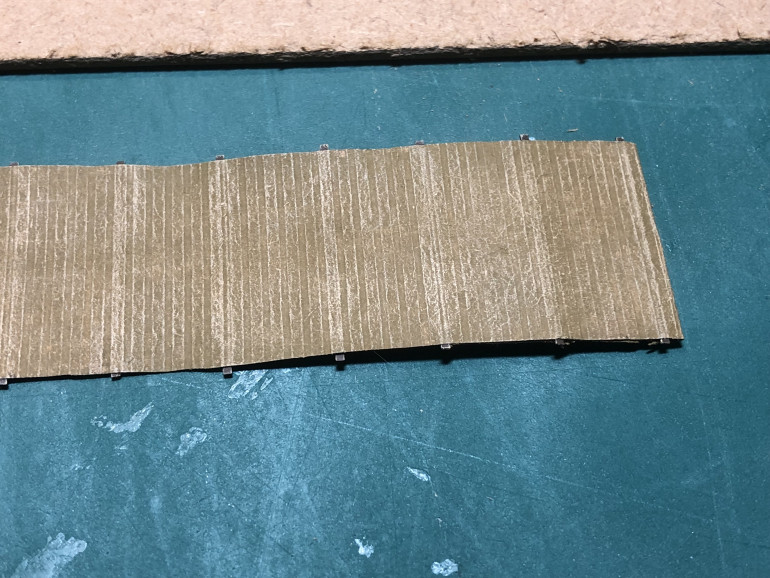Whilst i had the Iraqi sand out, i also used it to drybrush the bobbin matting. this really brought out the texture of the parcel paper i used.