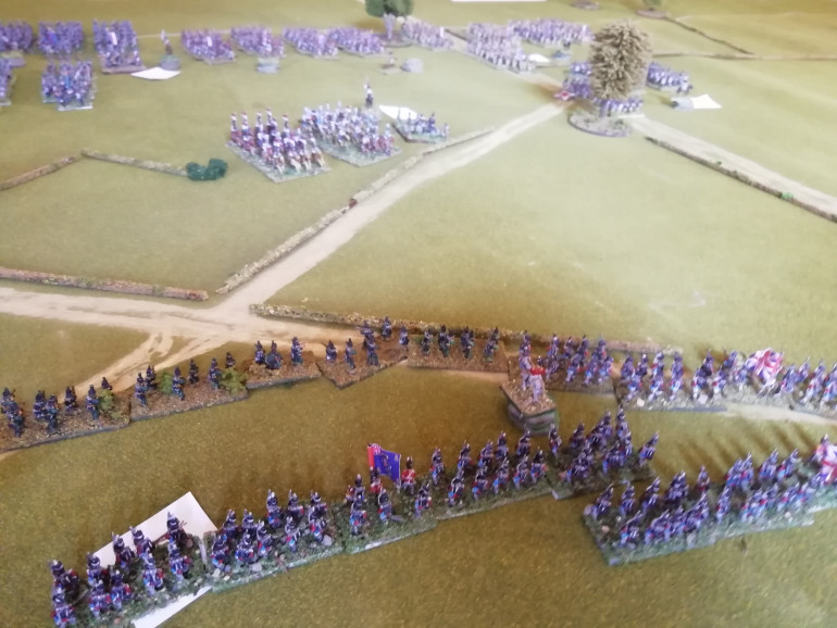 Redcoats and rifleman defend the hedgerow as the vanguard approaches