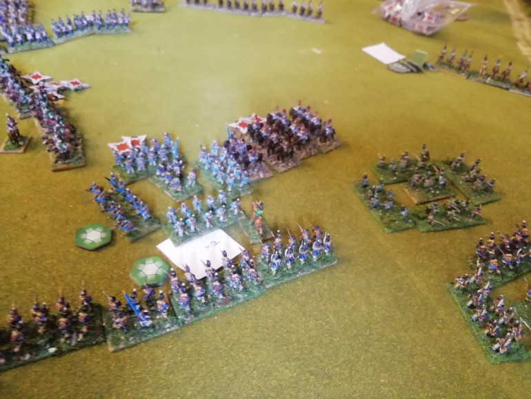 Cuirassiers bypassing the squares hit the Dutch militia in line and after wiping them out crash into the next unit along. On either side of the field cavalry does it's damage